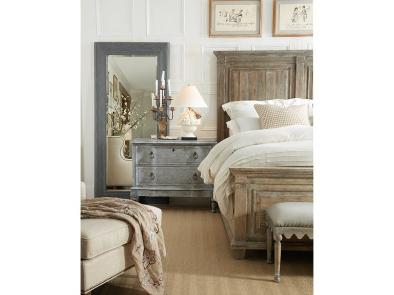 To the Hooker Furniture Bedroom Boheme Laurier King Panel Bed, the right setting is a beige carpet that complements the overall theme in the room.