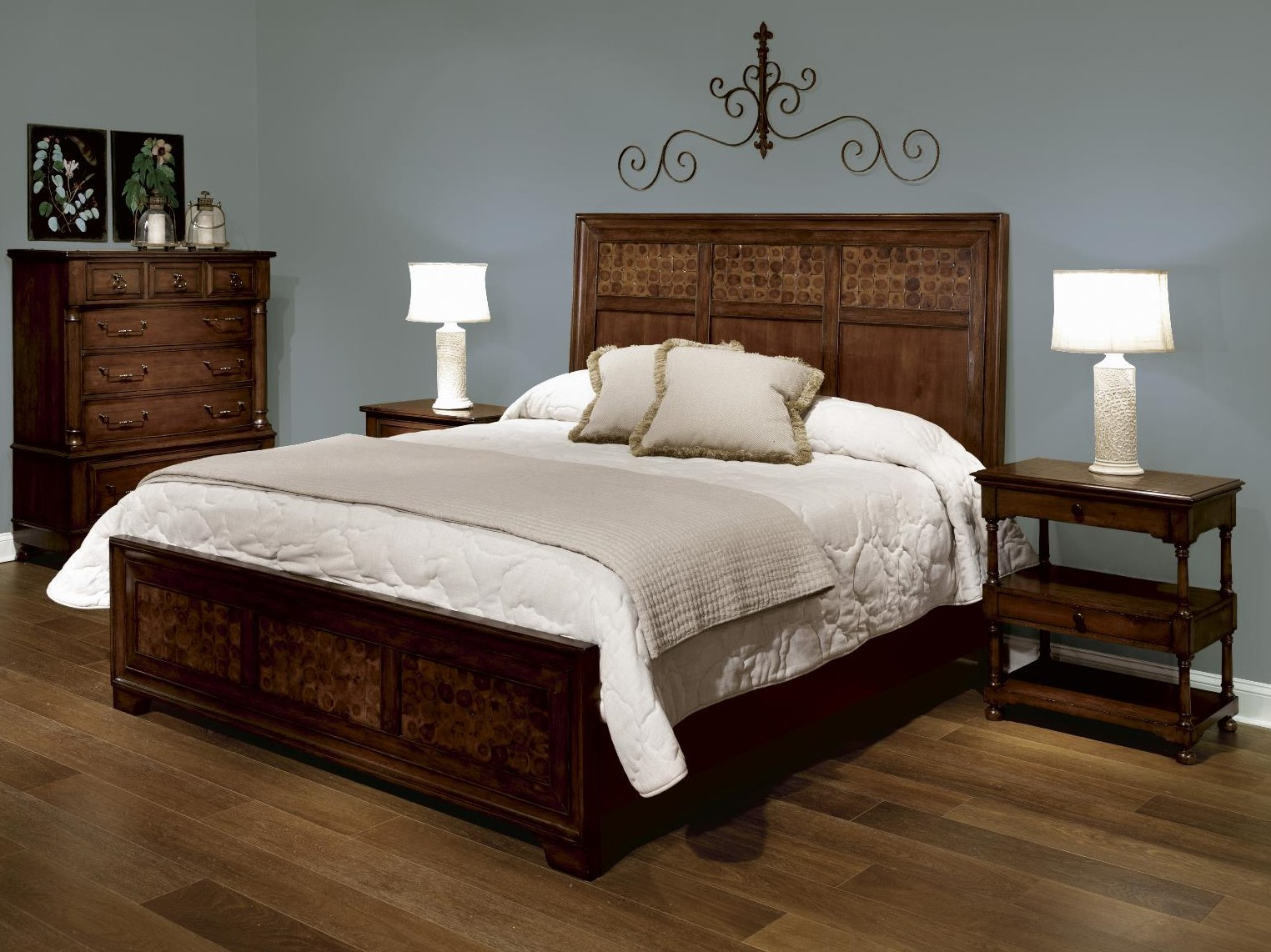 Featured furniture is the Port Panel KING Bed from the Harbor Springs Collection. Notice how it fits the ensemble like a glove? The wood flooring is the ...