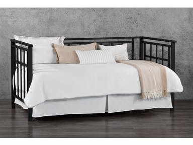 This Wesley Allen Bedroom Daybed can double as a couch during the day.